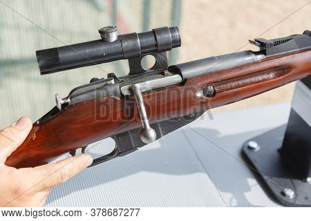 Fragment Of A Rifle With An Optical Sight. The Rifle Is Ready For Shooting.