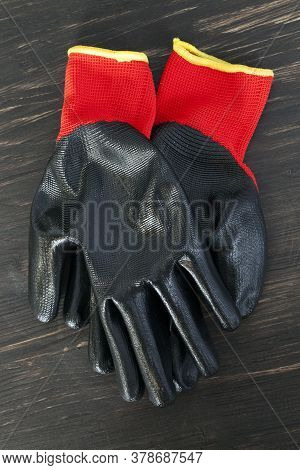 Black Rubberized Gloves-construction Tools For Repair, Construction And Other Types Of Work, Close-u