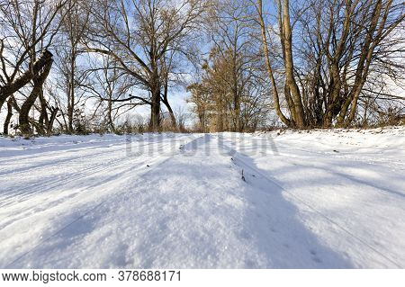 Snow Covered Winter Road For Car Traffic, Frosty Snow Weather And Blue Sky, Sunny Day On The Road, S