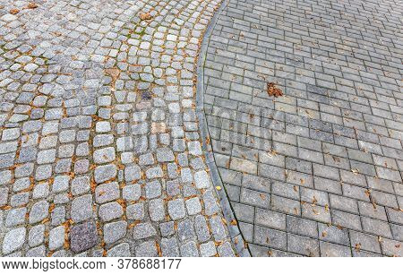 Close-up Of The Road For Pedestrians And Walkers Made Of Concrete Tiles, Possible Movement Of Motor