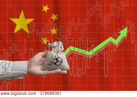 The Concept Of Economic Growth In The Country People Republic Of China. Hand Holds A Bag With Money