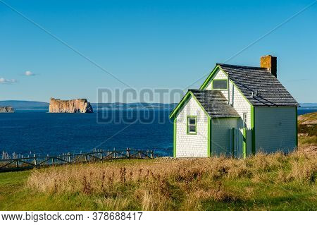 Green House And Rocher Perce Rock In Gaspe Peninsula, Quebec, Gaspesie, Canada