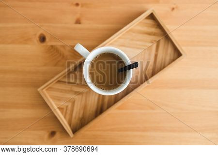 Oat Milk Latte Mug From Top Down Perspective On Bamboo Tray On Matching Wooden Table With Minimalist