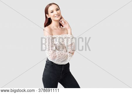 Portrait Of Smiling Beautiful Caucasian Young Woman Wearing Stylish Casuals