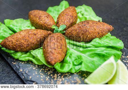 Delicious Lebanese  Food, Kibbeh (kibe) On Black Slate Stone And Granite Background.