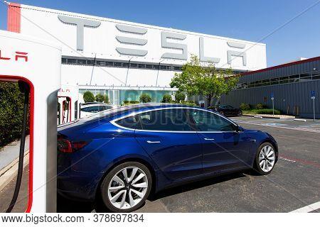 Fremont, Ca - May 1, 2020: Tesla Model 3 Charging At Supercharger Station At Tesla Factory In Fremon
