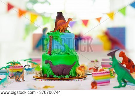 Kids Birthday Party. Dinosaur Theme Layer Cake. Children Event. Decoration For Dinosaurs Themed Cele