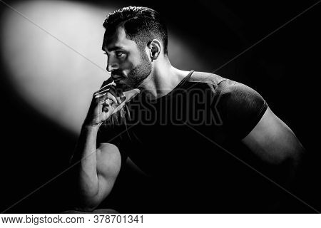 Black And White Portrait Of Young Strong Man Thinking About Something