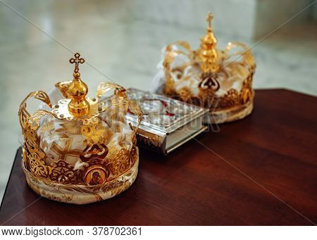 Two Crowns And Bible On Holy Altar For The Wedding Ceremony In The Russian
