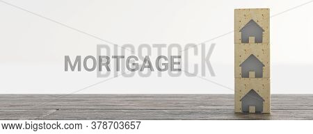 Mortgage Concept. Wooden House Model With Text Mortgage. 3d Rendering