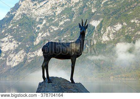 Bohinj, Slovenia, September 30, 2019: Lake Bohinj Statue Of Gold Horned Chamois