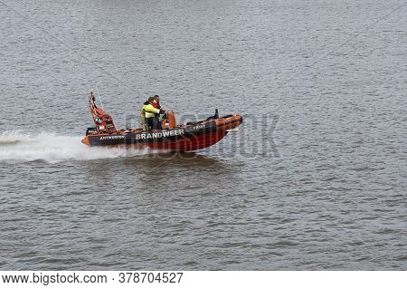 Antwerp, Belgium, July 19, 2020, Rescue Boat Of The Fire Brigade With Two People On Board