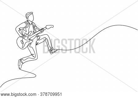 One Continuous Line Drawing Of Young Happy Male Guitarist Jumping While Playing Electric Guitar On M