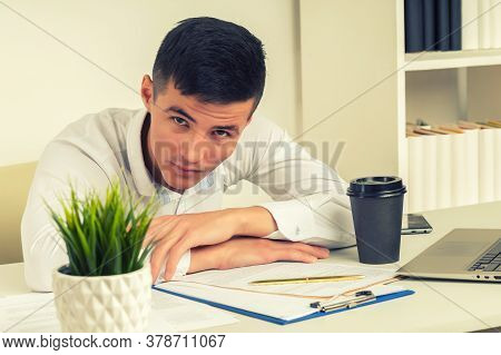 Tired Asian Businessman Sleeping In Office. Middle Eastern Business Man Worked Late And Fell Asleep