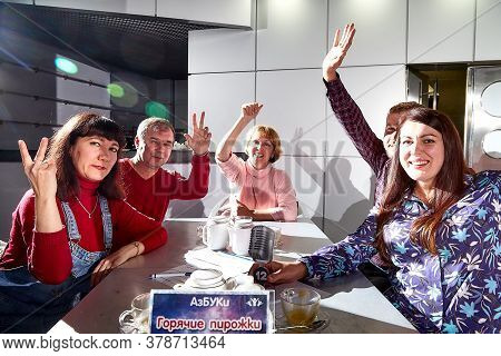 Kirov, Russia - September 25, 2019: People At Tables In Cafe Or Restaurant Posing For Photographer D
