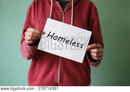 A Young Homeless Boy Stands With A Sign And Asks For Help. Homelessness Concept.