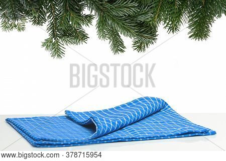 Empty Bright Tabletop With Blue Checkered Napkin For Presentation Of Goods On A Christmas Time With