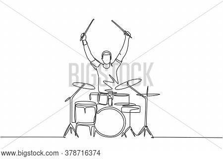 One Single Line Drawing Of Young Happy Male Drummer Raise Drumstick Up While Play Drum Set On Music