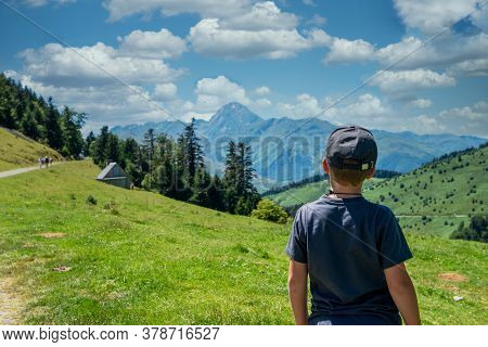 A Boy Looking Pic Du Midi De Bigorre In The French Pyrenees Mountains