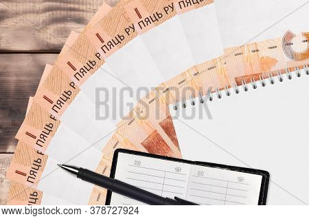 5 Belorussian Rubles Bills Fan And Notepad With Contact Book And Black Pen. Concept Of Financial Pla