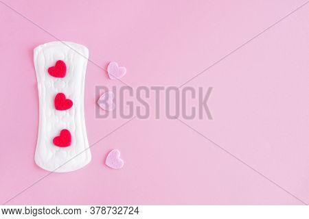 Sanitary Pad On A Pink Background. An Alternative Choice Of Feminine Hygiene Products. Menstrual Mot