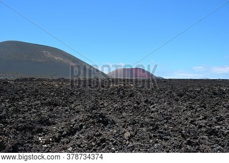 The Vast Emptiness And Loneliness Of The Lanzarote Black Frozen Lava Volcanic Desert And  Volcanoes