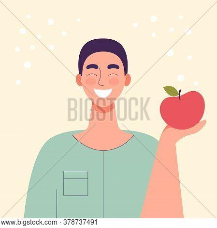 The Man Is Eating An Apple. Diet Food, Healthy Lifestyle, Vegetarian Food, Raw Food Diet. Student Sn