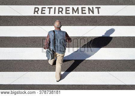 Retirement Concept. Scene Of A Senior Man Walking In A Cebra Crossing Towards Retirement Text. Top V
