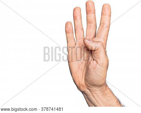 Hand of caucasian middle age man over isolated white background counting number 4 showing four fingers