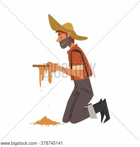 Male Prospector, Bearded Gold Miner Character Wearing Vintage Clothes And Hat Standing On His Knees