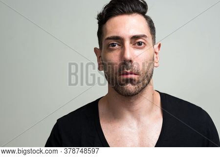 Portrait Of Handsome Man With Beard Stubble