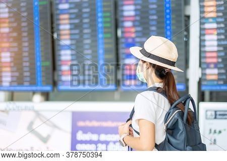 Young Adult Female Wearing Surgical Mask In Airport Terminal, Protection Coronavirus Disease (covid-