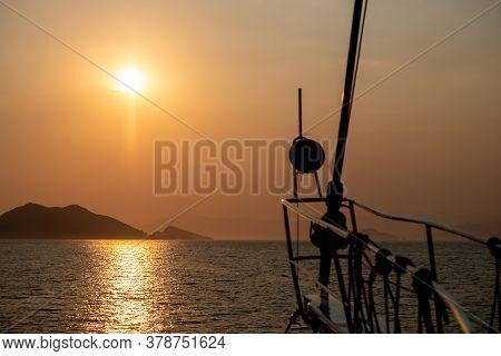 Boat At Sea While Sun Set At Summer