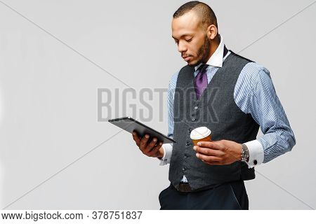 Professional African-american Business Man Holding Tablet Pc And Cup Of Coffee