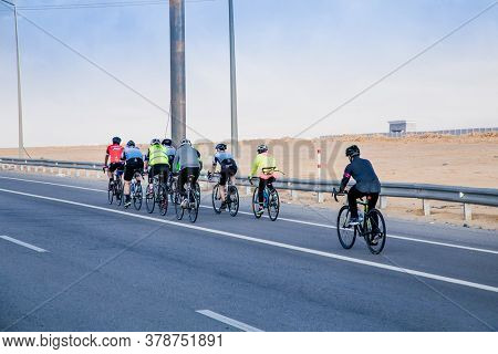 Caikro, Egypt-Jan 31, 2020:  A group of cyclists train on the way to Cairo, Egypt.