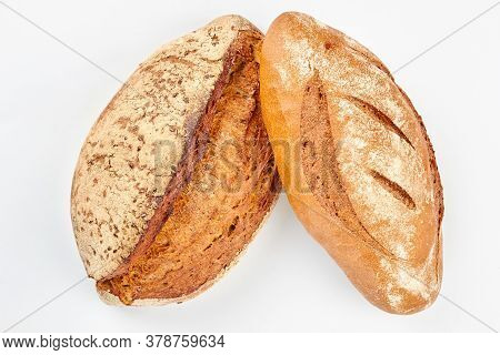 Artisan Bread On White Background. Two Loaves On Wheat Bread On White Background.