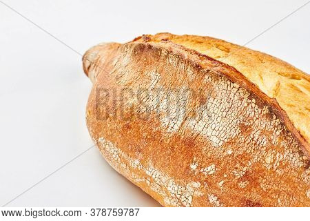 Freshly Baked Bread On White Background. Rustic Crusty Bread Recipe.