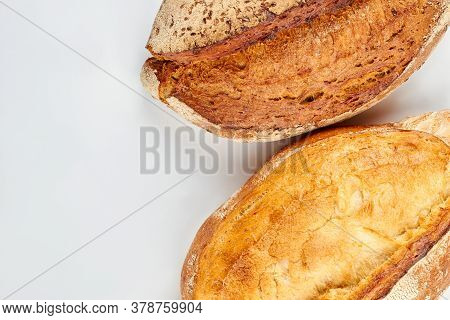Fresh Crusty Bread And Copy Space. Homemade Bread Loaves Isolated On White Background.