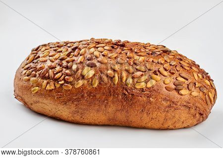 Organic Grain Wholemeal Sourdough Bread. Artisan Organic Wholemeal Bread Loaf. Isolated On White Bac
