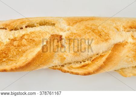 Close Up Of Fresh French Baguette With Crust. Crispy French Bread Texture. Isolated On White Backgro