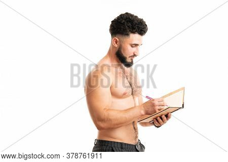 Writing Master. University Student Do Writing Task Isolated On White. Handsome Man Write In Copybook