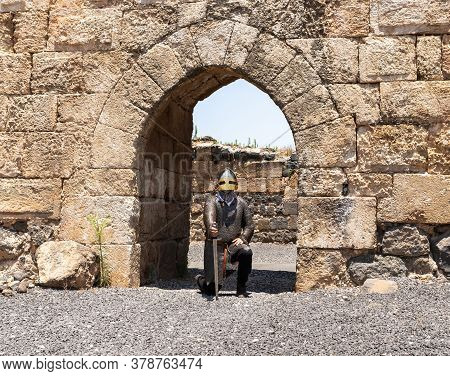 Afula, Israel, July 18, 2020 : The Medieval Knight Stands And Guards The Passage In The Great Hospit