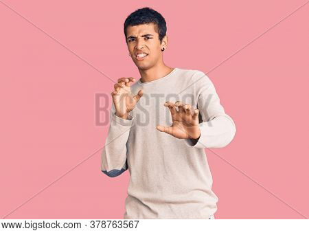 Young african amercian man wearing casual clothes disgusted expression, displeased and fearful doing disgust face because aversion reaction. with hands raised