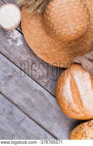 Tasty Homemade Bread With Flour On The Table. Flat Lay With Healthy Farmers Bread, Hat And Bowl With
