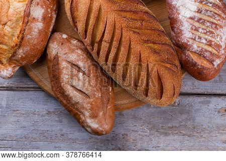 Freshly Baked Wholemeal Bread. Delicious Crispy Bread On Rustic Wooden Background. Artisan Bread Rec