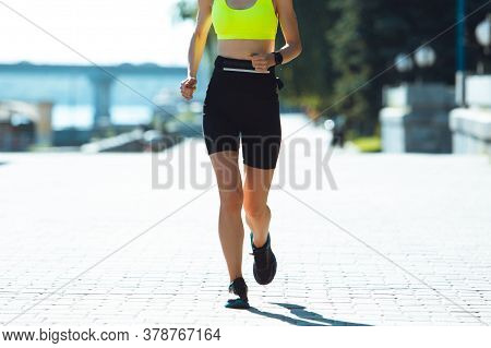 Close Up, Details. Female Runner, Athlete Training Outdoors. Professional Runner, Jogger Working Out