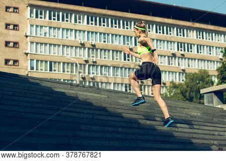 Upstairs. Female Runner, Athlete Training Outdoors. Professional Runner, Jogger Working Out On The S