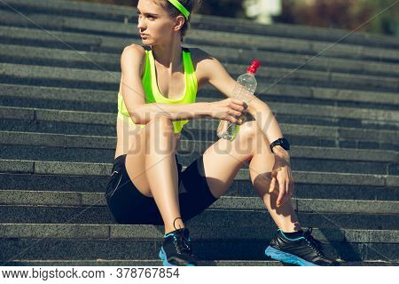 Taking A Breathe. Female Runner, Athlete Training Outdoors. Professional Runner, Jogger Working Out