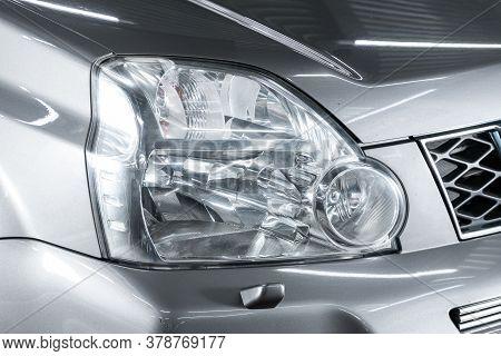 Novosibirsk/ Russia - April 28  2020: Nissan X-trail,  Silver Car Headlights. Exterior Detail. Close