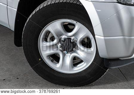 Novosibirsk/ Russia - June 30  2020:  Suzuki Grand Vitara,  Car Wheel With Alloy Wheel And New Rubbe